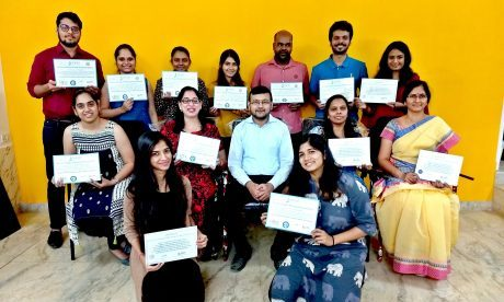 Group photo of students receiving certificates after completing their coaching and psychotherapy certification